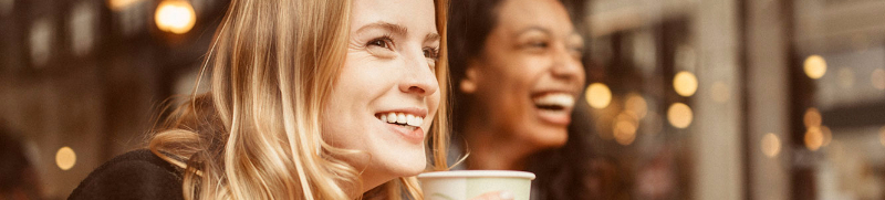 Women having coffee and smiling