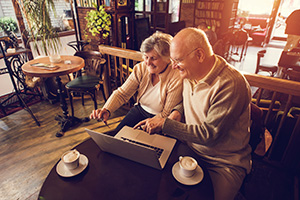 Senior couple on computer