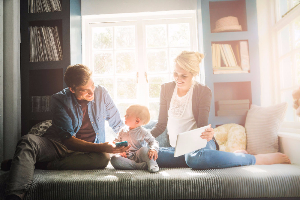 Family with toddler sitting on window seat